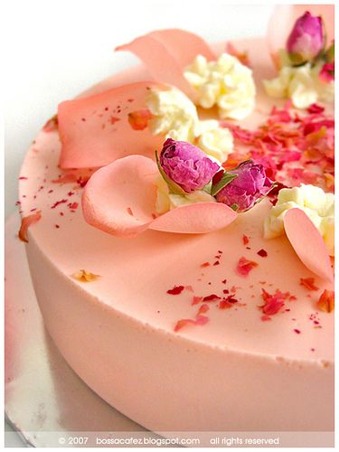 rose tea cheesecake topped with fresh rose petals and dried rose buds