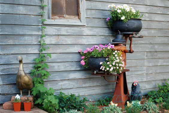 This old cream separator makes a cool planter garden for Garden separator