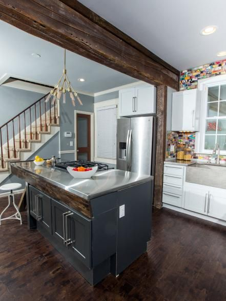 Ok.... This back splash is innovative. I'm not a skateboarder but the tiles are reclaimed wood from skateboards. The splash of color on the wall is GREAT! It's a great contrast to the the stainless and cabinets. Plus, what a wonderful, creative way to introduce color and personality into a home! I love it!