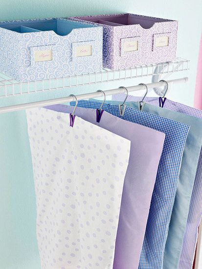 Add slits to old pillow cases to turn them into garment bags. #organization