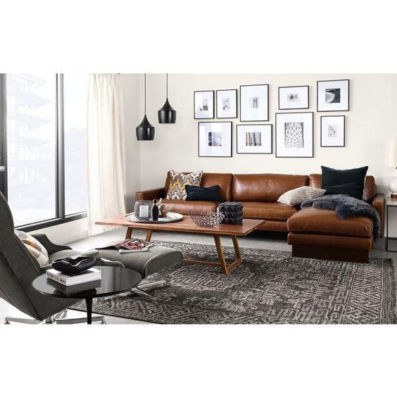 Trang trí phòng khách nhỏ, dài với sofa da tphcm