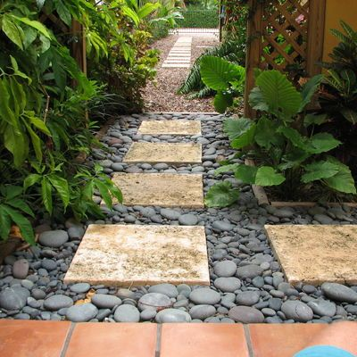 Tranquil path of pavers river rock and hostas this for Rock stepping stones landscaping