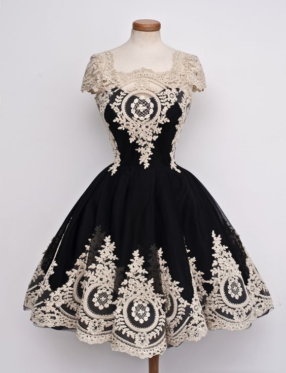 http://banquetgown.storenvy.com/collections/1321911-homecoming-dresses/products/16674846-gorgeous-black-cap-sleeves-homecoming-short-with-lace-homecoming-gowns-short