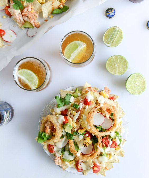 summer BBQ chicken nachos with buttermilk onion rings and white ...