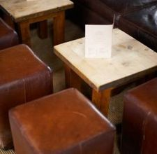 Make a padded leather (or pleather) ottoman with lid from an old trunk
