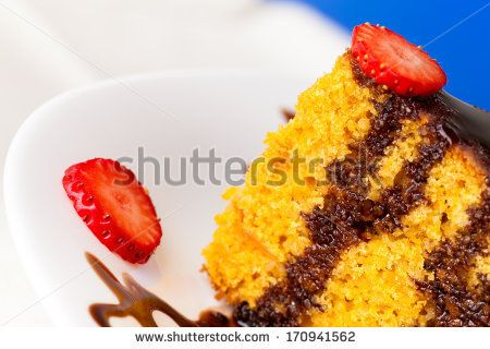 Piece of carrot cake decorated with chocolate and strawberry slices. by eZeePics Studio, via Shutterstock
