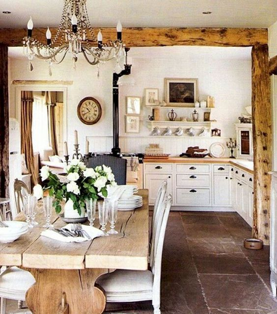 Rustic white kitchen with rugged wood beams and farm table. 40 Beautiful European Country Kitchens. #european #country #kitchen #rustic