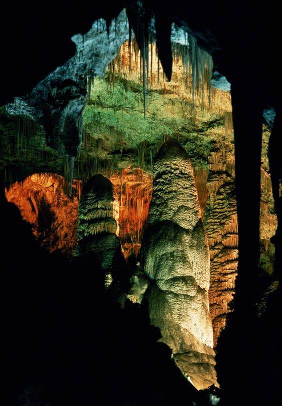 New Mexico's Carlsbad Caverns is a system of 119 ancient caves hidden below the landscape, formed when sulfuric acid dissolved limestone that surrounded it. The climate inside is cool, and makes an exciting stop for caving, either on a self-guided or ranger-guided tour. When the sun sets, listen to a ranger talk just before watching the caves' bats fly out into the sky. Get more information about Carlsbad Caverns.  - WomansDay.com