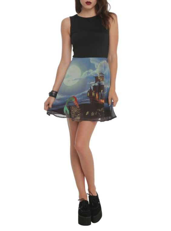 Dress from Disney's The Little Mermaid with a solid black top and Ariel & ship designed skirt. Back zipper closure.