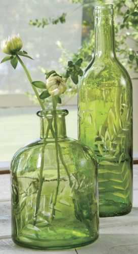 Green bottles re-purposed as vases for wildflowers serve as decor throughout the comfy abode | Grandin Road Color Crush on Citrine More: