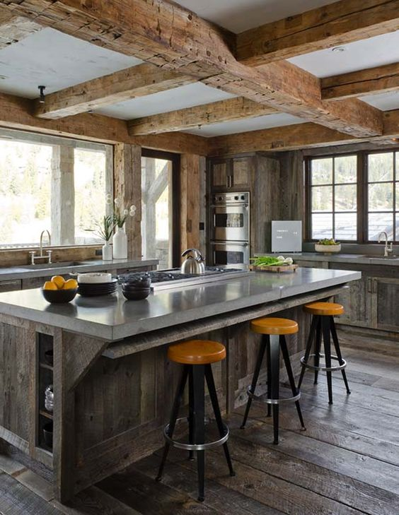 this could be fabulous with those tin ceiling tiles - I don't think the orange stool seats though.....Kitchen Concrete Countertops-16-1 Kindesign