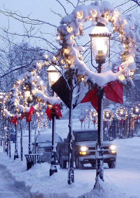 Old-time lampposts in Christmas decoration.. Petoskey, Michigan, U.S  /  - -Bookmark  Your Local 14 day Weather FREE > http://www.weathertrends360.com/Dashboard  No Ads or Apps or Hidden Costs