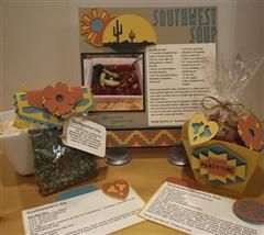 A paper crafted way of sharing a trio of Southwest recipes perfect for a themed party.The nuts and dip mix are great for favors!My project includes an 8x8 recipe scrapbook page for Southwest Soup, a bag topper for a dip mix packet with recipe card for Southwestern Dip, and a decorated nut cup with recipe card for Southwest Spiced Nuts.