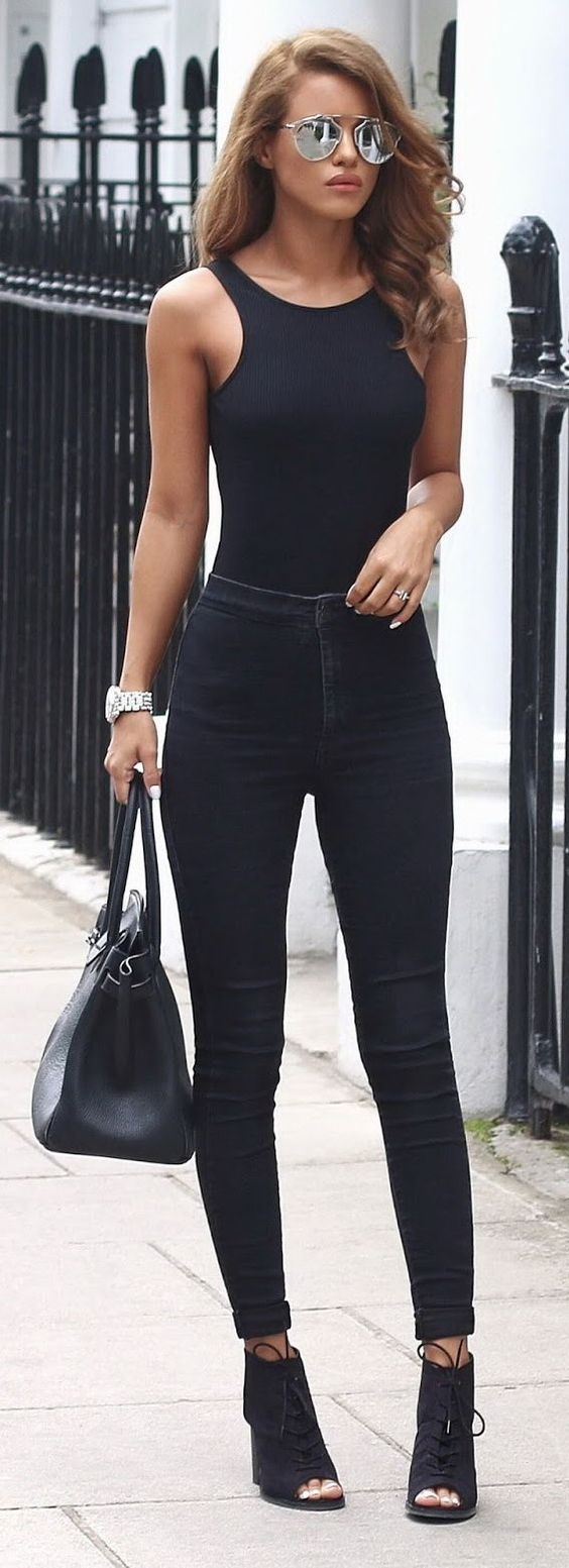 "And all-black outfit AND silver reflective sunglasses? This is for when a woman wants that ""it oughta be illegal to look this cool"" look. #streetstyle #chic"