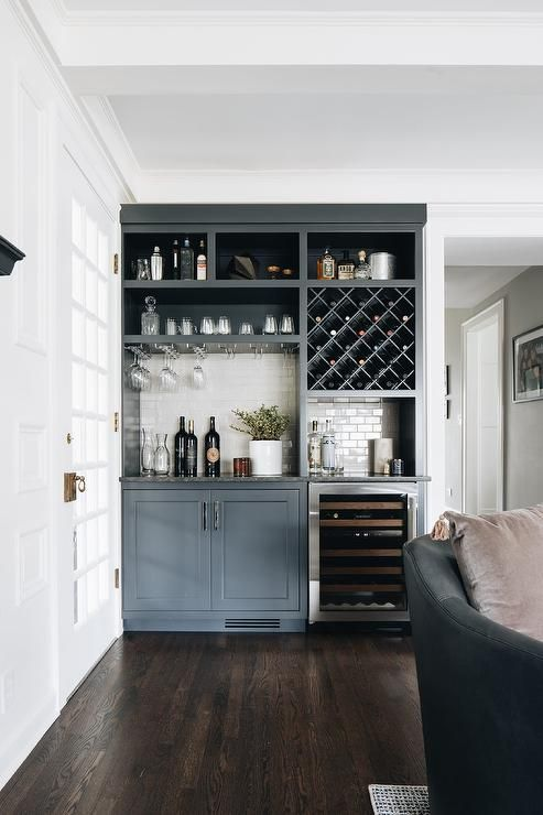 Gray Living Room Bar Features Dark Gray Cabinets Finished With A Glass Front Wine Fridge Fixed B In 2021 Bar In Living Room Living Room Bar Built In Bar In Living Room