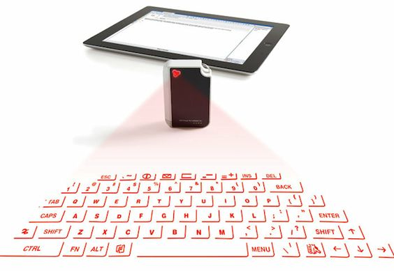 Virtual keyboard keychain with bluetooth  Projects keyboard onto any flat surface!