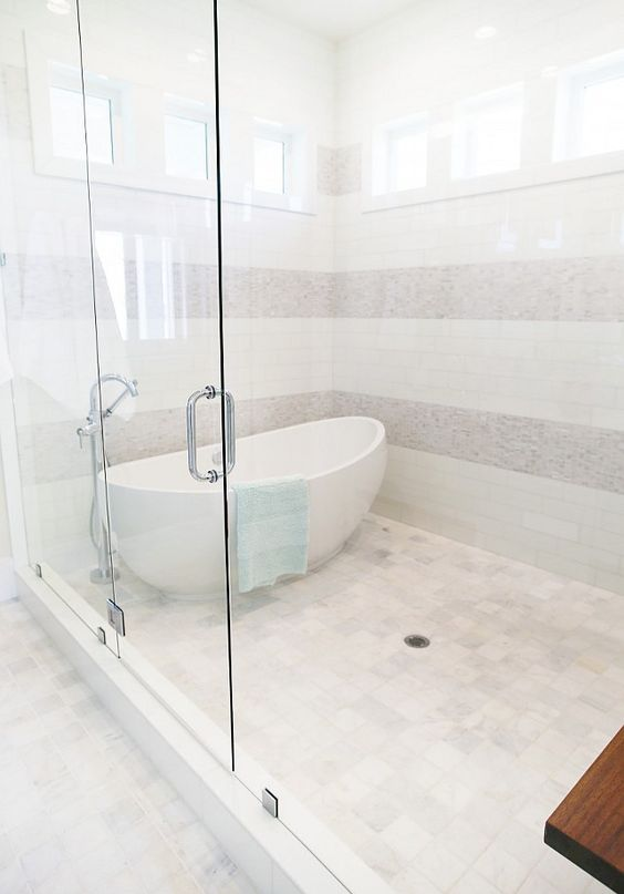 freestanding bath inside of shower tub in shower free