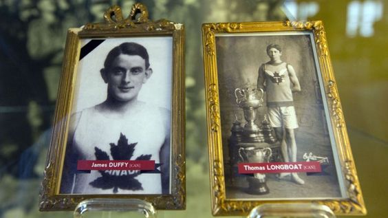This photo contains illustrations of World War I soldiers and Boston Marathon winners James Duffy, 1914, and Tom Longboat, 1907, framed behind glass on exhibit at the In Flanders Fields Museum in Ypres, Belgium. (AP) – See the story at http://www.foxnews.com/world/2015/04/19/boston-marathon-winner-who-died-century-ago-in-wwi-honored/