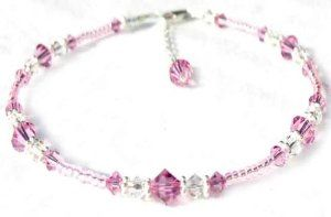 Damali .925 Sterling Silver Anklet Green & Pink Heart (Anahata) Chakra Anklet for fertility, harmony, hope, balance, and self respect Damali. $49.95. Genuine Swarovski Austrian Crystals. Secure lobster clasp closure. Adjustable 1 Inch chain extenstion included. .925 Sterling Silver. Genuine freshwater pearls