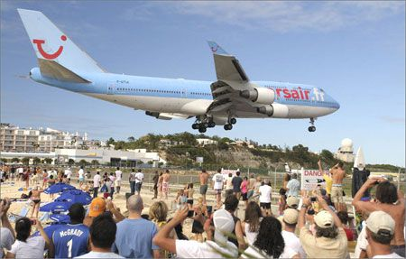 Maho Beach >>>At the Sunset Bar & Grill at the end of the runway at SXM, St. Maarten