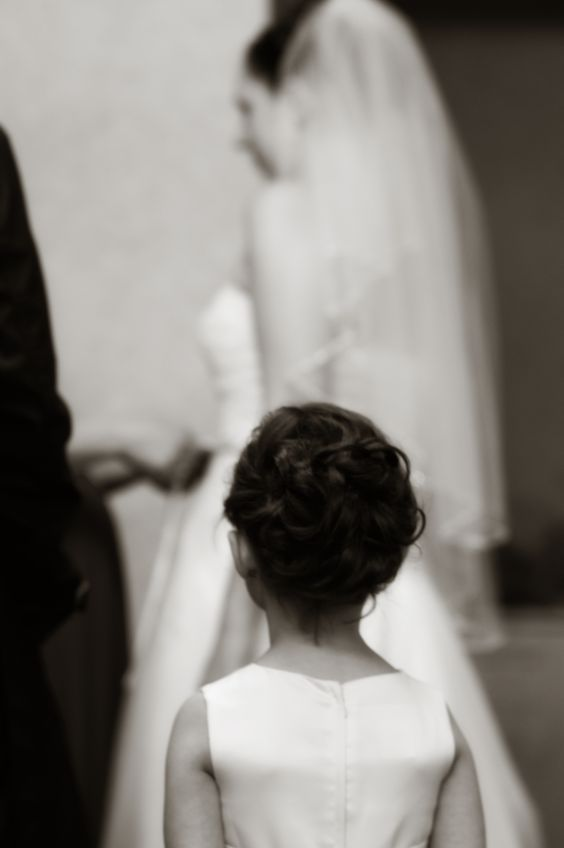 flower girl watching bride