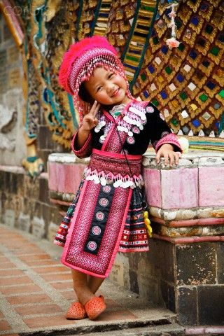 Little girl posing in traditional clothes, Chiang Mai, Thailand. Photo: Blake…