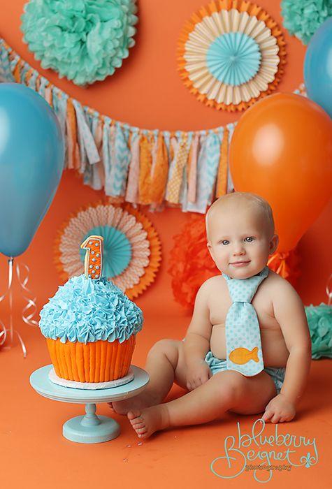 Giant cupcake orange and blue cake.  Cake smash.