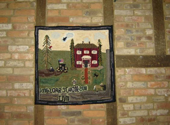 My first large rug. A primitive depiction of Zoar School Inn Bed and Breakfast circa 1936. Completed in the spring of 2011