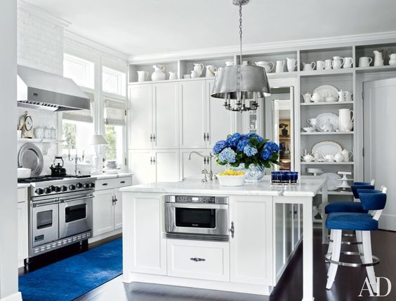 Clean whites with pops of #blue.  Beautiful. Traditional Kitchen in Los Angeles, California: Living Room, Traditional Kitchen, Kitchen Design, Blue Accents, Light Fixture, Open Shelving, White Kitchens