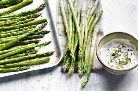 Dip asparagus spears into this fragrant, creamy orange and basil dip for a heavenly summery snack. | Tesco