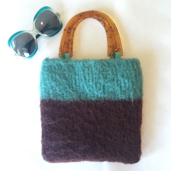 Funky vintage turquoise & brown fuzzy bag. Funky vintage turquoise & brown fuzzy bag with plastic clear brown handle. In excellent condition. No spots on the inside. Vintage Bags