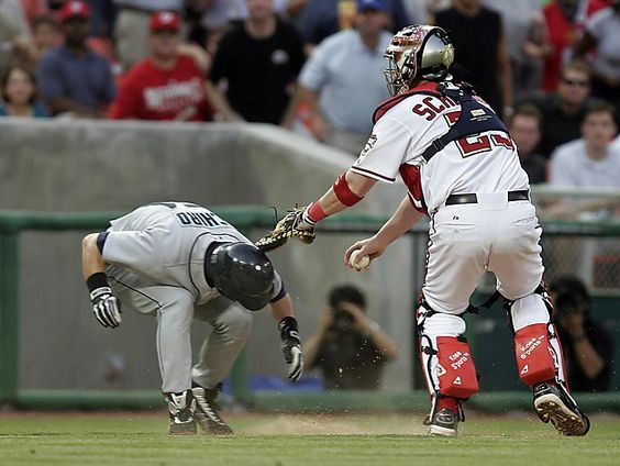 Washington Nationals catcher Brian Schneider tags out Seattle Mariners star Ichiro Suzuki of Japan. Schneider was a scrappy and great field general catcher for the Nats.