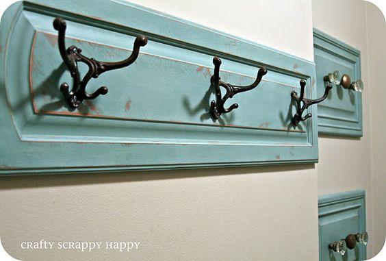coat hanger display made from an old cabinet door