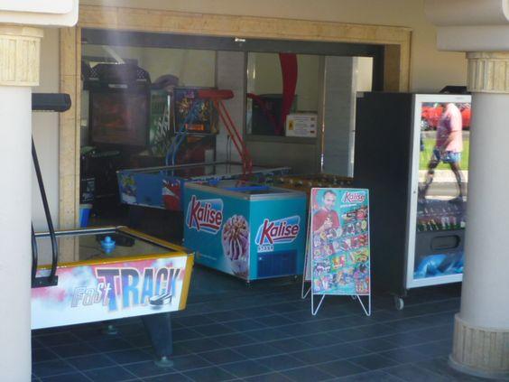 2(a) outside an amusement arcade.