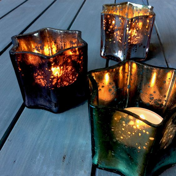 Smoked, antique-effect glass star votives at the Handmade Craft House