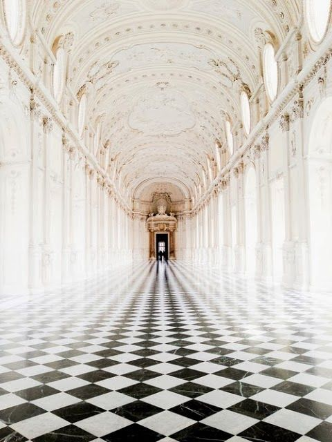 COCOCOZY: DIAGONAL CHECKERBOARD FLOORS - Love this long arched ornate hall with the black and white checkered floor laid on the diagonal.