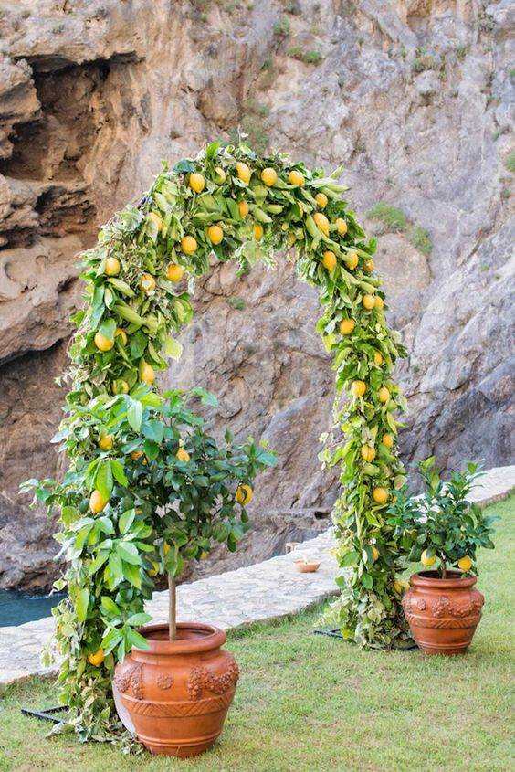 20. (Above) Ahh, the ultimate romance of a destination wedding on the famed Amalfi coast! What could be more fitting than a wedding arch made of lemons, to celebrate the Italian's love of Limoncello? {Floral design: Flora Garden// Photography Rochelle Cheever of A Romantic Journey photography} Click to See more of this Positano destination beach wedding