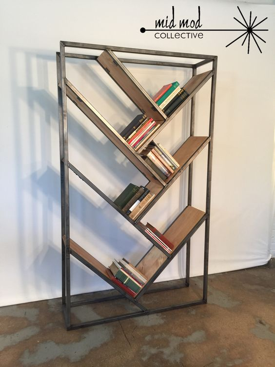 Custom fabricated, metal & wood bookcase. Available at Mid Mod Collective. Email midmodcollective@gmail.com for info. SOLD!
