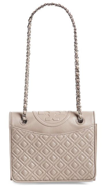Medium fleming leather shoulder bag by Tory Burch. A topstitched logo medallion crowns a diamond-quilted shoulder bag crafted from lustrous lambskin...