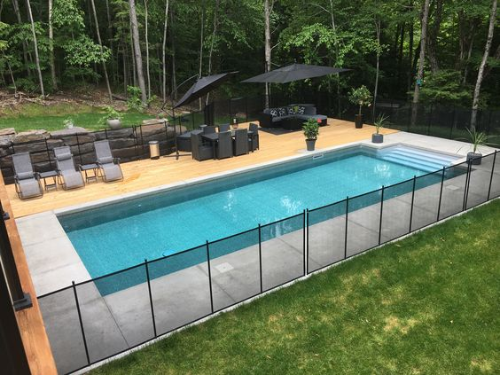 Pool Safety Barriers For Your Backyard Fencing For In Ground And Above Ground Swimming Pools Backyard Inground Removable Pool Fence Inground Pool Landscaping