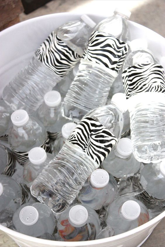 Duct tape dresses up water bottles for a party. - what a great idea!!