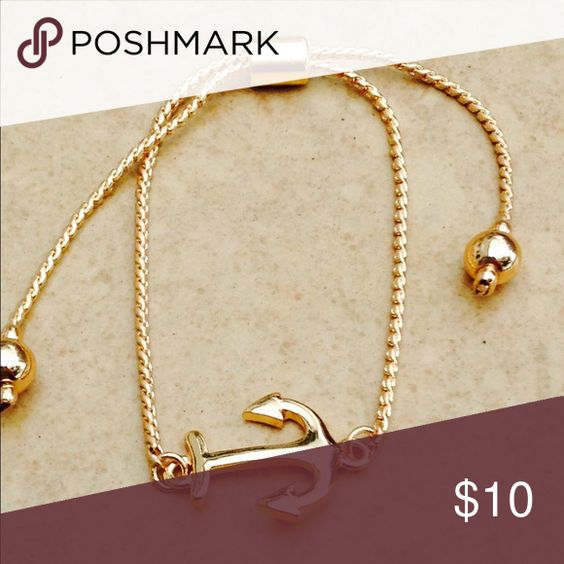 Gold Tone Adjustable Sliding Anchor Nautical Gold tone polished finish bracelet features a nautical anchor attached at the center of a chic chain with a sliding tension clasp that makes this adjustable bracelet one size fits most.  Anchor measures 1/2 inch L x 3/4 inch W. Jewelry Bracelets