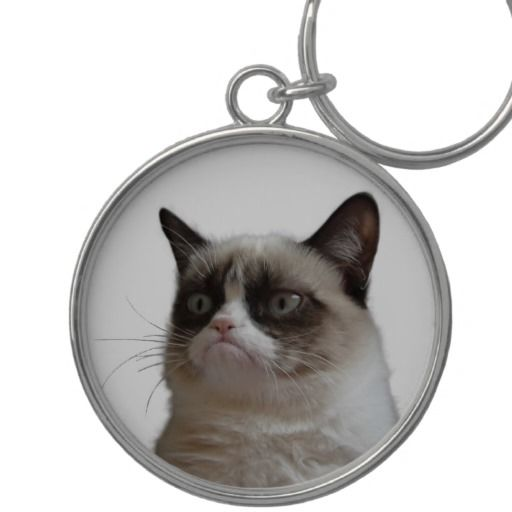 """Official #GrumpyCat ™ Stare Premium Round #Keychain. Silver colored metal charm & ring, UV resistant and waterproof. Size: 2.125"""". Price: $29.95"""