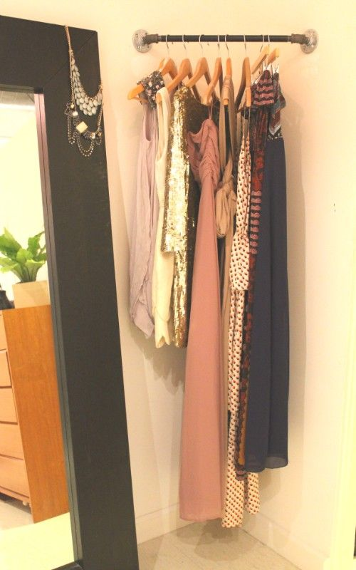 Corner rod for planning outfits and what to wear the next day. Good idea