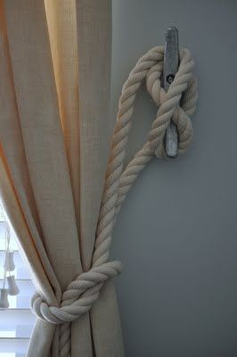 Nautical rope cleat for curtain holdbacks.