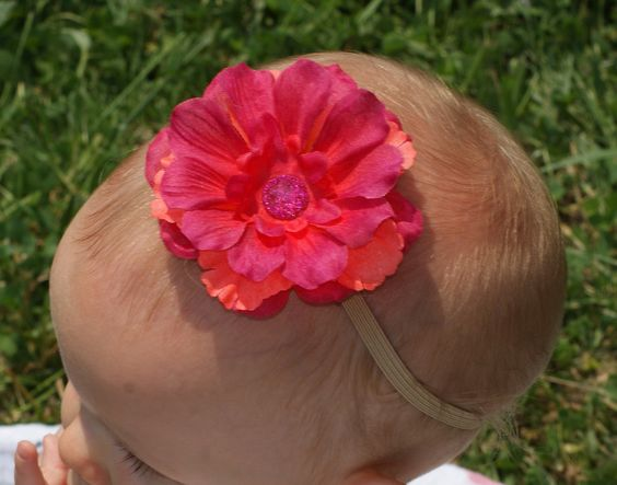 Fuchsia/coral flower Infant Headband with glitter button on skinny camel elastic. $8.95, via Etsy.
