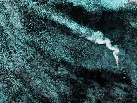 A plume arises from a volcano on Zavodoski, one of the South Sandwich Islands, located off Argentina