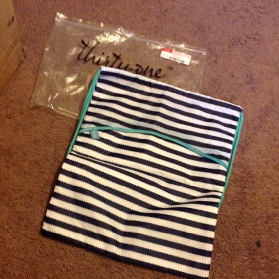 Thirty one 31 navy wave cinch sac backpack new Brand new in the package, only opened for photos. Rare hard to find retired pattern.  Navy wave cinch sac backpack. Thirty one Bags Backpacks