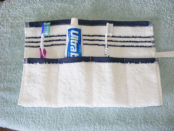 A clever way to store your toothbrush etc for travel. The terry cloth absorbs moisture yet keeps the brushes clean.