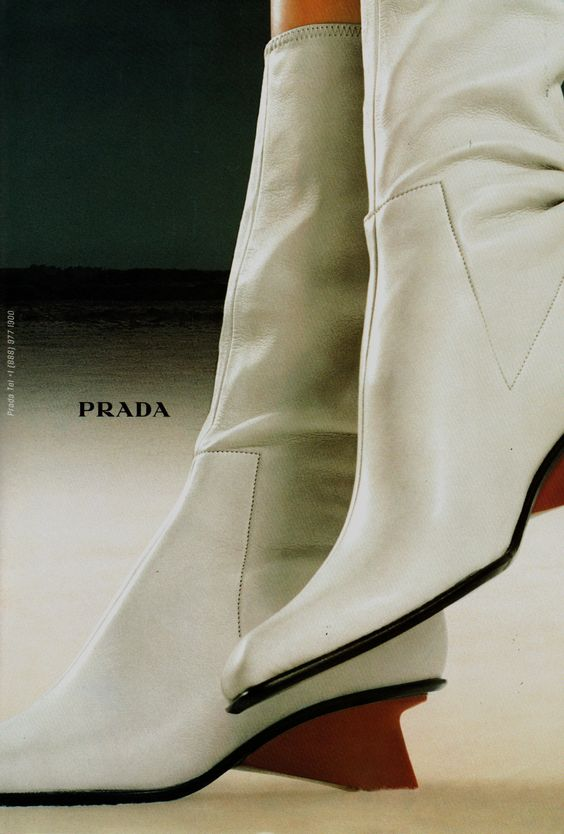 A 1998 Prada ad for mod-looking mid-calf boots in white leather with sculpted red wedges. Totally wearable today.